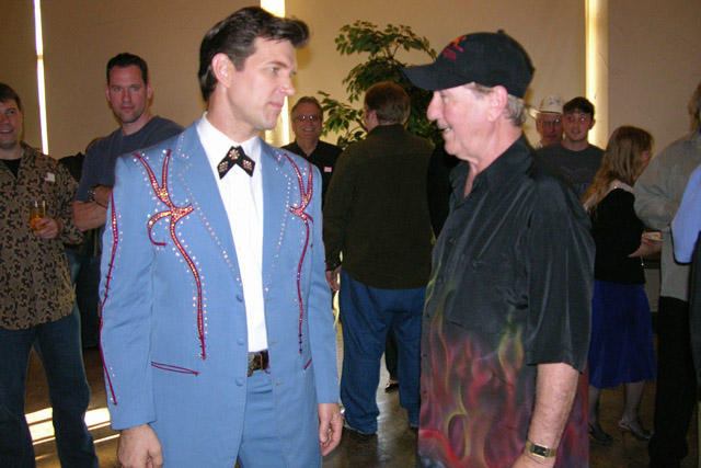 The guy in blue here is Chris Isaak, a popular guitarist.