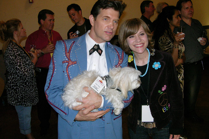 Even the dogs are treated like VIPs on this night. That's Chris Isaak holding the dog.